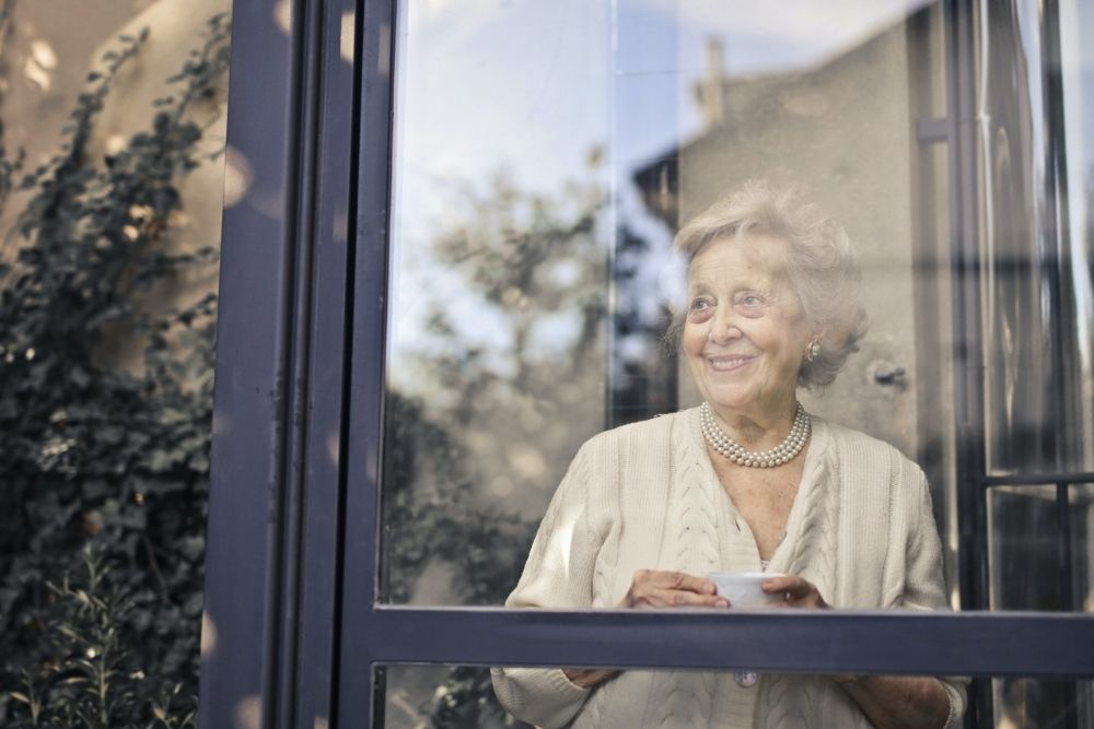 middle aged woman by the window