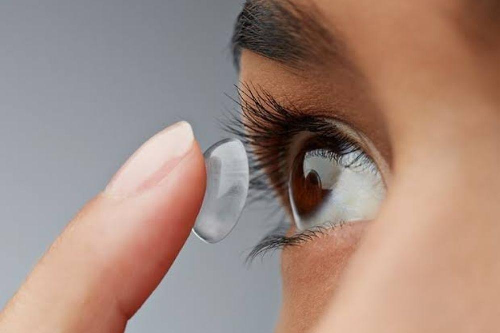 closeup of woman wearing contact lens