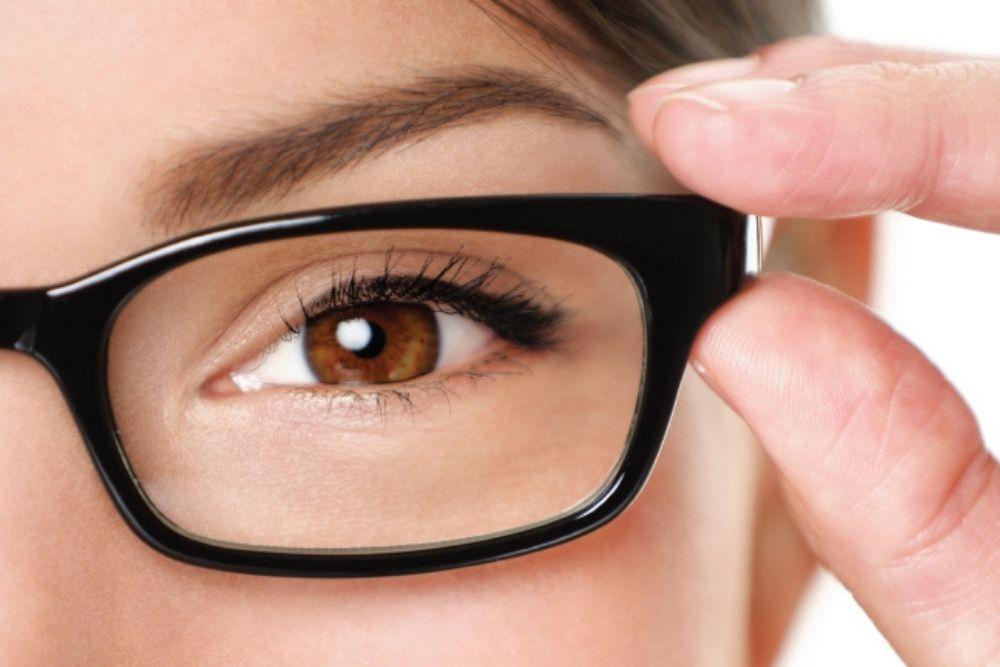 woman wearing a black pair of eyeglasses