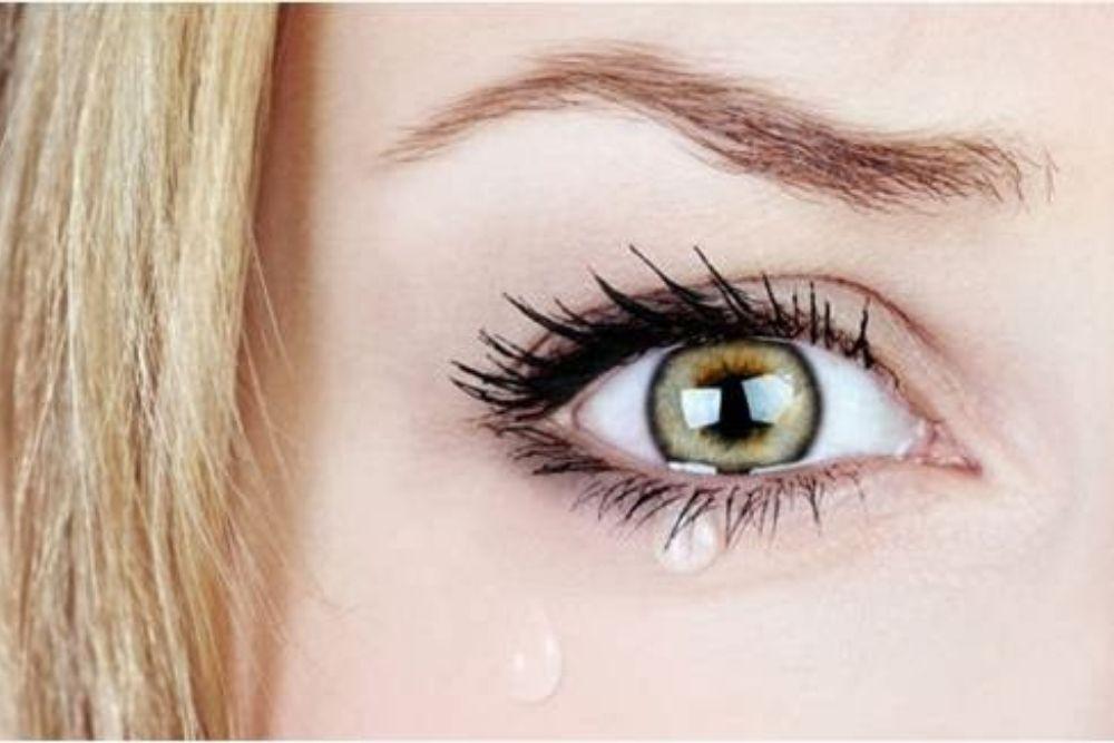 tears on woman's eye
