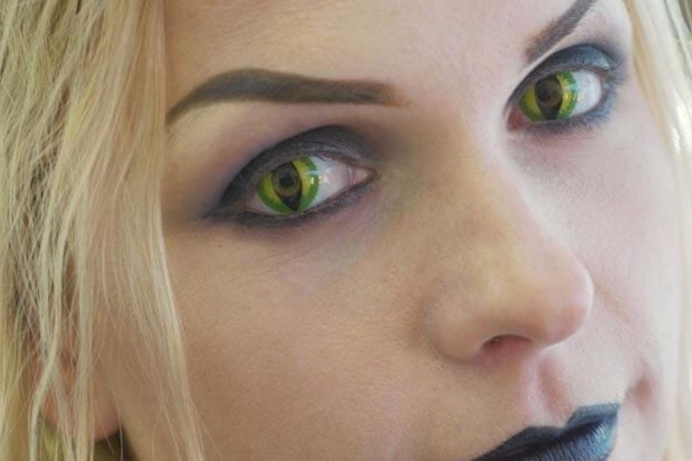 green contact lens on woman