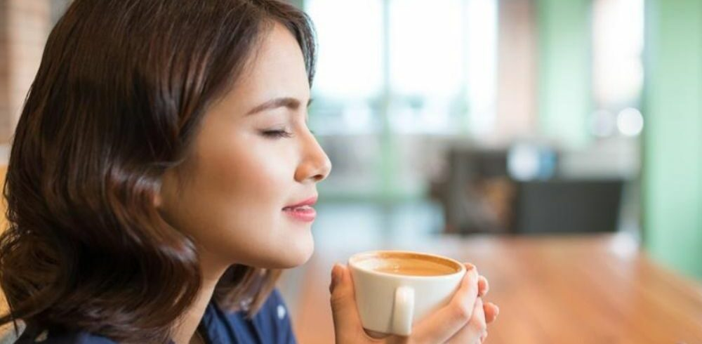 woman about to sip coffee