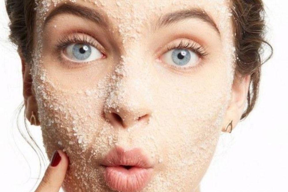 scrub on woman's face