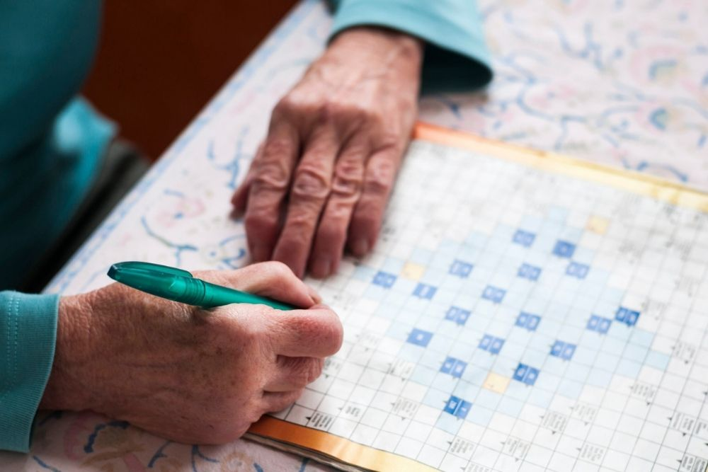middle aged woman solving puzzle