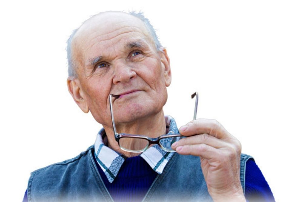 middle aged man holding a pair of eyeglasses